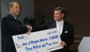 FedEx executive Alan B. Graf Jr. presents Memphis AD R.C. Johnson with $3 million donation.
